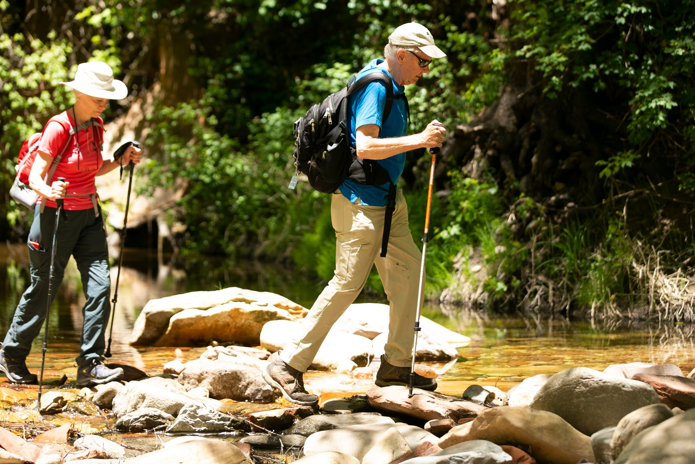Former Arizona Gov. Bruce Babbitt and his wife, Hattie Babbitt, hike across the West Fork of Oak Creek near Sedona. Babbitt started coming to this wilderness area with his family when he was a boy.