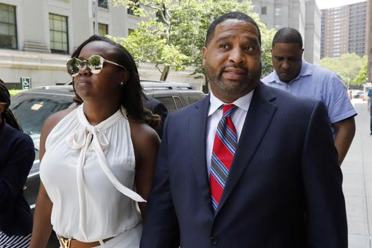 Former University of Arizona assistant men's basketball coach Book Richardson leaves Manhattan federal court in New York, after he was sentenced on Thursday.