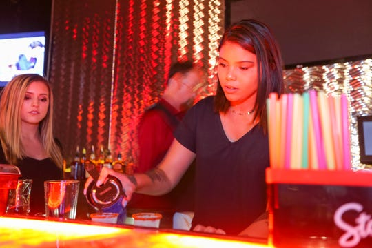 Bartender Kymberly Reed prepares a drink at Club 30 inside the Ramada Palms near University Avenue and Valley Drive on Wednesday, June 5, 2019.
