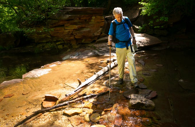 Former Arizona governor and U.S. Secretary of the Interior Bruce Babbitt crosses the creek during a 6-mile hike in the West Fork of Oak Creek Canyon, in the Red Rock-Secret Mountain Wilderness.