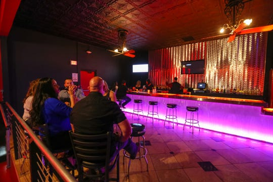 Patrons drink at Club 30 inside the Ramada Palms near University Avenue and Valley Drive on Wednesday, June 5, 2019.