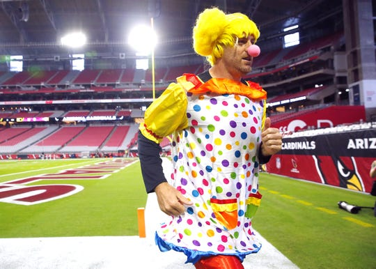 Cardinals quarterback Carson Palmer runs around at University of Phoenix Stadium dressed as a clown before playing against the Los Angeles Rams October 2, 2016. He lost a bet in a weekly quarterbacks competition.