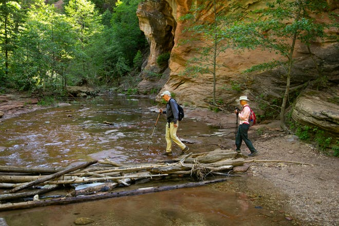"Bruce Babbitt and his wife, Hattie, hike across the West Fork of Oak Creek Canyon. Babbitt said he thinks the trail is ""one of those places where people really want to come because it so intensely and immediately has this wonderful, refreshing and recreating kind of aspect to it."""