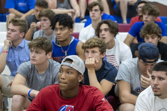 Football players Marcus Williams, WR 2020 team, in front left, upset over his firing Arcadia High School head football coach Kerry Taylor.