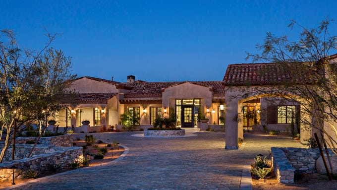 The $4 million north Scottsdale estate purchased by Robert and Lori Cantero has a stone covered circular automotive courtyard.