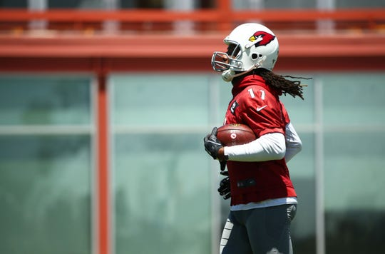 Cardinals wide receiver 	Larry Fitzgerald (11) practices at OTAs on Wednesday.