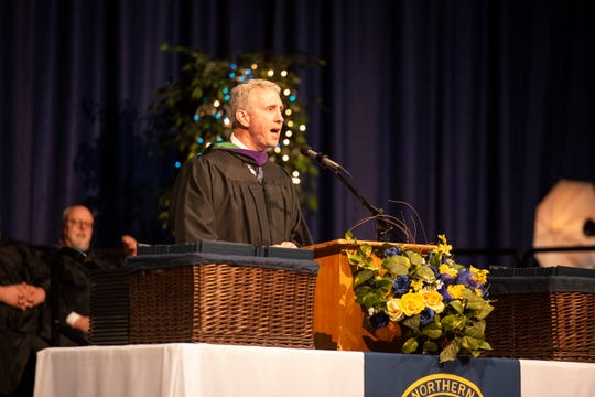 Port Huron Northern graduate and United States Attorney for the Northern District of Iowa Peter E. Deegan, Jr. delivers the keynote address during the school's commencement ceremony Wednesday, June 5, 2019 at McMorran Arena.