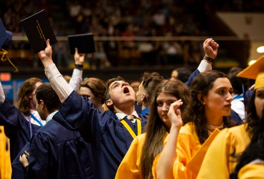 Port Huron Northern graduating senior Brendan Webster cheers after the school's commencement ceremony Wednesday, June 5, 2019 at McMorran Arena.