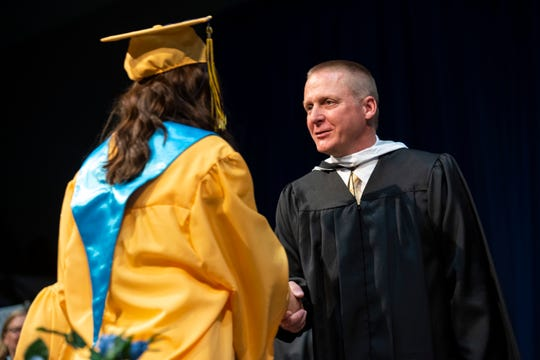 Port Huron Northern Principal Charles Mossett shakes a student's hand during the school's commencement ceremony Wednesday, June 5, 2019 at McMorran Arena.