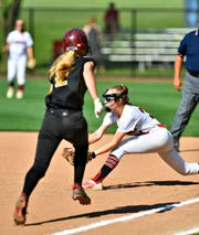 Bloomsburg's Olivia Hull, right, catches the ball to out Delone Catholic's Lauren Little at first during PIAA Class 3-A softball quarterfinal action at Lebanon Valley College in Annville, Thursday, June 6, 2019. Bloomsburg would win the game 5-1. Dawn J. Sagert photo