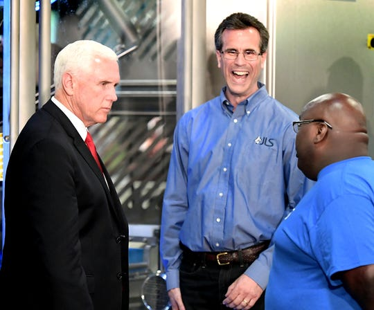 Vice President Mike Pence talks with JLS Automation employees Craig Hafner and Kevin Jenkins, right, while touring the Springettsbury Township business Thursday, June 6, 2019. Bill Kalina photo