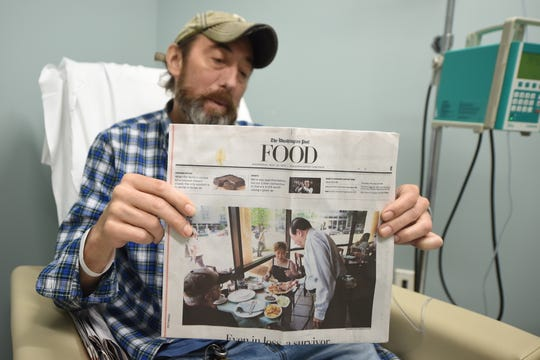 James Gibble, 50, holds a copy of The Washington Post during a chemotherapy treatment at Cancer Care Associates of York in York Township. Gibble was diagnosed with Stage 1 lung cancer in Oct. 2018. In March, doctors found two more spots on his liver.