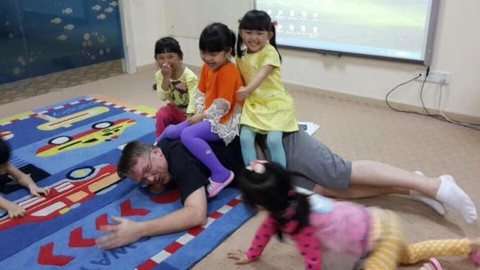 Chad Albright left the United States to take a job teaching children in China.
