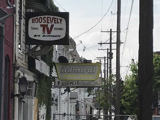 The building housing the iconic York business Roosevelt TV was demolished Thursday. The structure was in poor repair and was condemned by the city.
