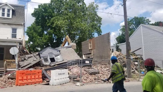 By mid-afternoon, the building that housed the iconic business was reduced to rubble.