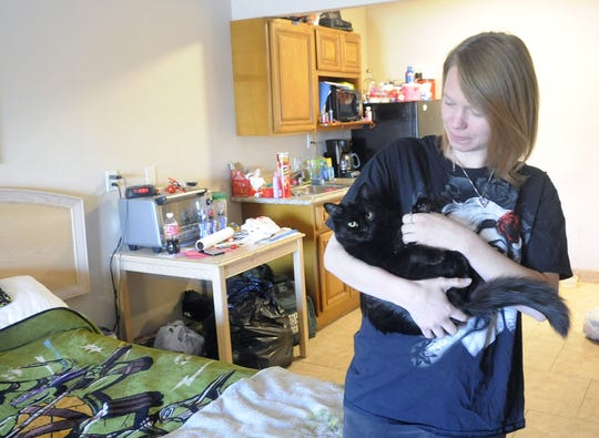 Erika Atkinson snuggles with her cat, Shadow. Atkinson, her two kids and Shadow shared one room at the Extended Stay in Fernley for almost a year.