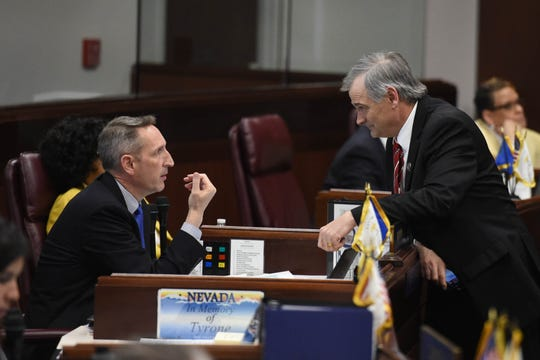 Nevada State Senators Scott Hammond, left, and James Settelmeyer chat during a break on the Senate floor on the last day of the 2019 Nevada Legislative session on Monday June 3, 2019.