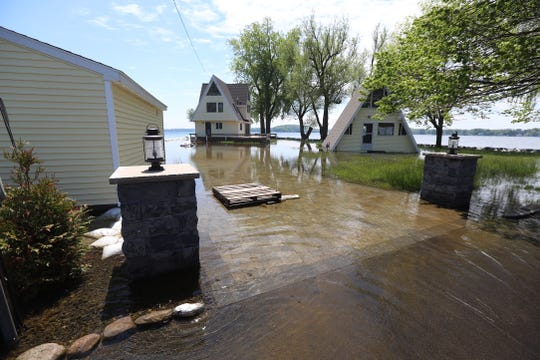 Homes alomg Gardenier Lane in Sodus Point are deling with flooded yards and water getting into their homes from the recent rain and high lake level that is raising the water level in Sodus Bay.