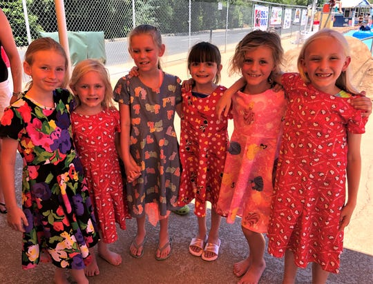 Mikinzy Gibson, left, Cassidy Gelms, Myah Murrell, Sophie Jauregui, Kylee Elison and Colette Gelms show off the dresses their teacher, Sue Horrocks, made for them.