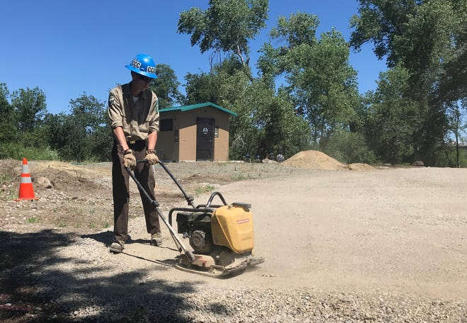 Isaac King, of the California Conservation Corps, works at the Henderson Open Space in Redding earlier this month. The CCC is partnering with the city to put in trails and a kayak launch in the area.
