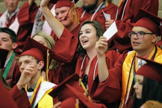 Seniors at West Valley High School receive graduation instructions before their commencement ceremony Wednesday.
