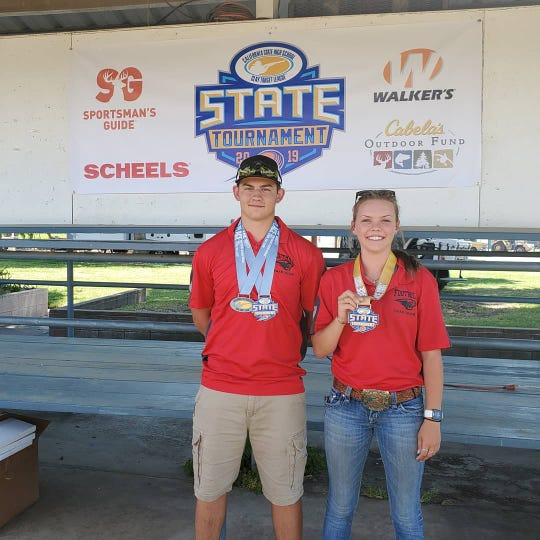 Brad Reagan, left, and Mason Baseley were some of Saturday's top performers at the state championship trap shooting tournament.