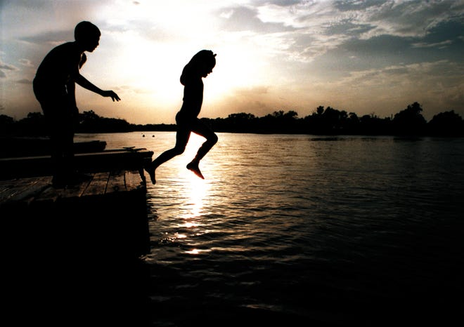 A brother and sister play at Lake Nasworthy in this file photo. More than 90% of Texas is drought-free and lake levels are up, according to the National Weather Service.