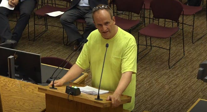 Christopher Bruce speaks during public input at the Sioux Falls City Council meeting June 4 at Carnegie Town Hall.