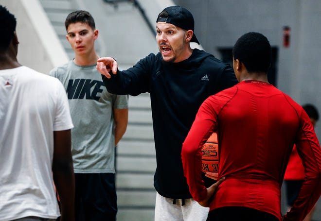 Mason Miller (in Nike shirt) looks on as his father, former NBA player Mike Miller, directs players at a recent camp in Memphis.