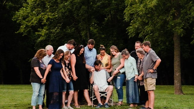 Before Galin Campbell's first treatment for non-Hodgkins lymphoma, his 11 siblings and parents gathered around to pray for him.