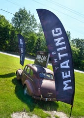 """An old car and signs announce the upcoming """"The Meating"""" event Thursday, June 6 at The Waters Church in Sartell. The event will be held Sunday and will feature 1 ton of barbecued meat for attendees."""