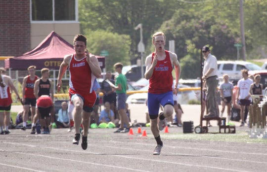 Ben Theisen competes in the 100-meter dash during a meet earlier this season.