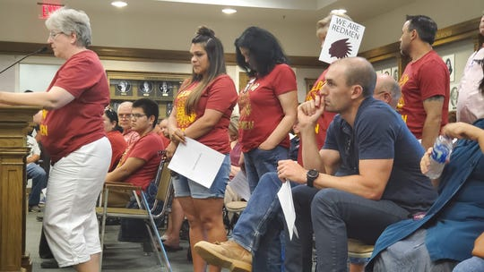 Hopeful speakers waited in line Wednesday in Cedar City to voice their opinions regarding a proposal to turn a water tank bearing the former Cedar High mascot into a monument.