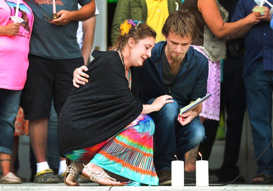 "In a Saturday, June 1, 2019 photo, Jessica Whipple is comforted by her fiancée Detrich Black during a candlelight vigil in remembrance of her daughter Elizabeth ""Lizzy"" Shelley on the steps of the Historic Cache County Courthouse in Logan, Utah. Shelley was abducted from her Logan home and found dead five days later in the backyard of a nearby residence. (Jeffery D. Allred/The Deseret News via AP)"