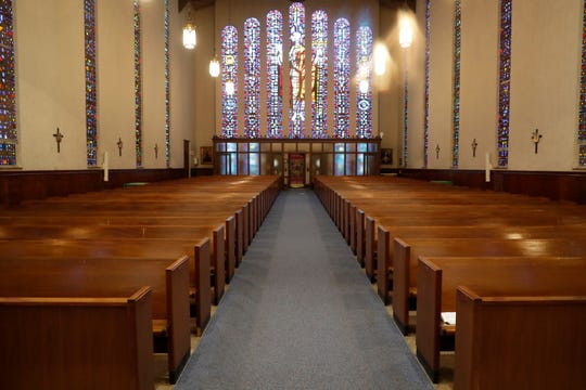 The pews at the Co-Cathedral of St. Thomas More will be empty for Easter but the services go on online.