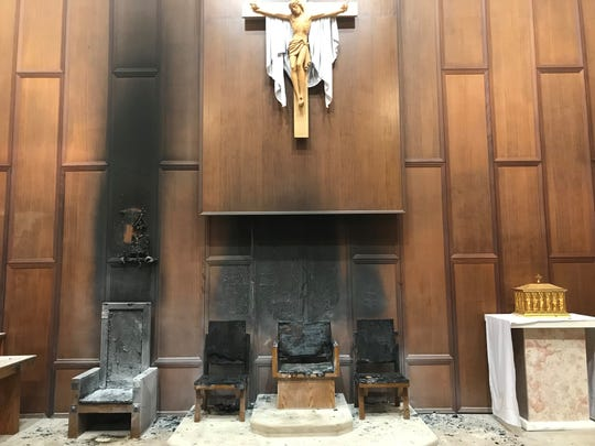 The sanctuary of the Co-Cathedral of St. Thomas More was heavily damaged in a fire Wednesday. Arson is suspected.