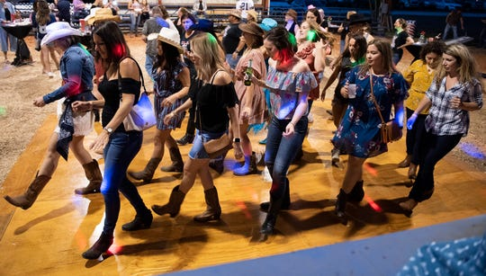 "Guests enjoy line dancing at the Raise the Roof for Hibiscus Children's Center ""Gone Country"" fundraiser at the Martin County Fairgrounds in Stuart."
