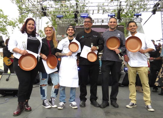 "Yummie Top Chef Culinary Competition winners pose with their saute-pan trophies at the 26th annual Casa Pacifica Angels Wine, Food & Brew Festival June 2 in Camarillo. From left, they are Julia San Bartolome of Sweet Arleen's, first place ""sweet;"" Anastashia Chavez of The 2686 Kitchen, second place ""sweet;"" Alex Montoya of Fluid State Beer Garden, third place ""sweet;"" Alex Castillo of Twenty88 Bistro, third place ""savory;"" Jeff Downey of The Saticoy Club, second place ""savory"" and Abdu Romero of Slate Bistro & Craft Bar, first place ""savory."""