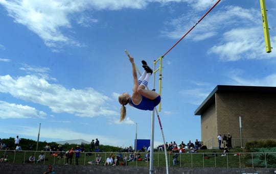 Paige Sommers soars over the bar in the Division 2 pole vault competition at the CIF-SS Track and Field Championships at El Camino College in Torrance. Sommers won the pole vault and the high jump titles.