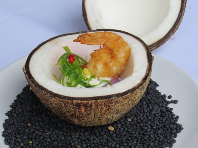 "A coconut doubles as the serving vessel for the first-place ""savory"" winner in the Yummie Top Chef Culinary Competition presented during the 26th annual Casa Pacifica Angels Wine, Food & Brew Festival. The dish by Abdu Romero, executive chef at Slate Bistro & Craft Bar in Camarillo, features Okinawan purple potatoes, ginger-coconut cream and a single coconut shrimp."
