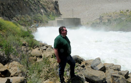 Brian Collins, operations and maintenance manager for United Water Conservation District, watches the release of 180,000 gallons per minute Wednesday at the Santa Felicia Dam at Lake Piru. This is expected to be one of the largest releases in years. The water flows down the Santa Clara River, where it is joined by runoff from Sespe and Santa Paula creeks.