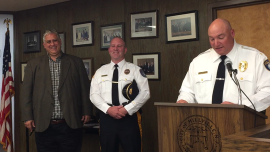 Millville police Chief Jody Farabella (podium) talks about Capt. Ross Hoffman (center), his newly promoted second-in-command. Hoffman stands with Commissioner Joseph Pepitone. It was one of three promotion ceremonies held at Wednesday night's commission meeting.