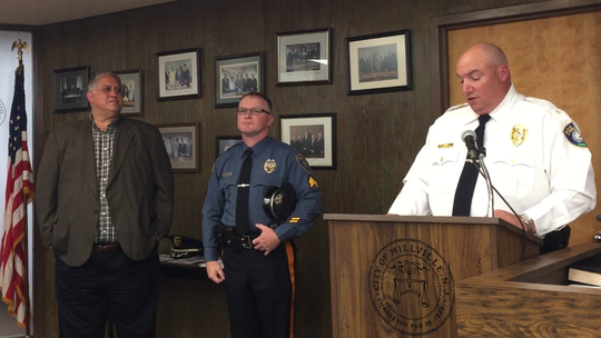Millville police Chief Jody Farabella (right) introduces Sgt. Robert Runkle (center) at City Commission's meeting Wednesday night. Left: Commissioner Joseph Pepitone.