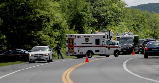 An ambulance pulls out onto Route 293 in West Point, New York, near where a vehicle carrying USMA personnel crashed during a training exercise Thursday morning, June 6, 2019.