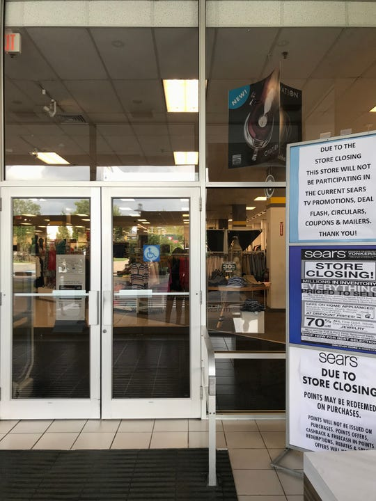 The Sears store at Cross County Shopping Center in Yonkers posts notices of its impending closing and the liquidation sale near the front entrance.