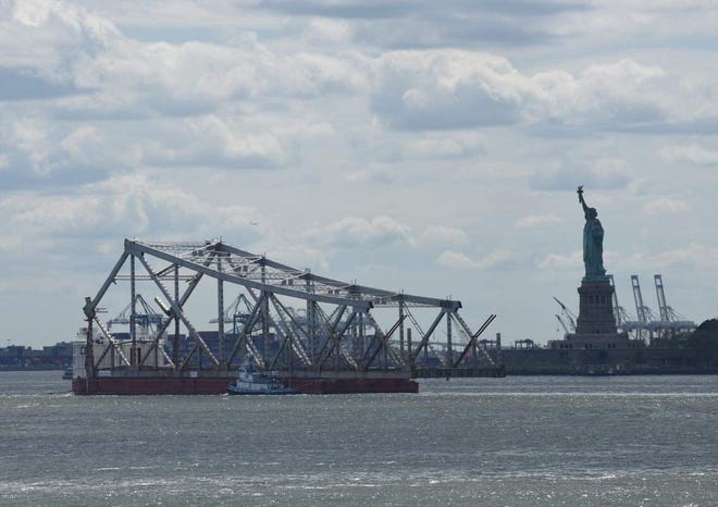 The Tappan Zee Bridge by the Statue of Liberty in New York Harbor.