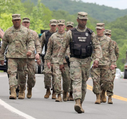 A command group, including Lt. General Darryl Williams, left, superintendent of the United States Military Academy at West   Point, walk towards the media after a vehicle carrying cadets crashed early Thursday, June 6, 2019, killing one cadet. The cadets were in being transported to summer training when the accident occurred.
