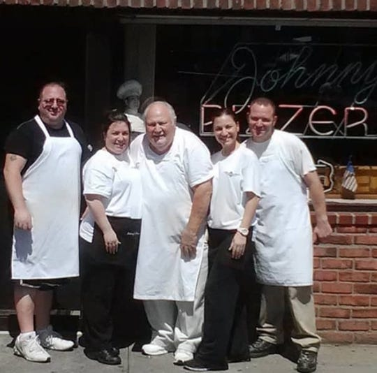 The Piscopo family outside Johnny's Pizzeria in Mount Vernon.