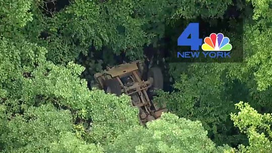 In this photo taken from video provided by NBC New York, a light medium tactical vehicle sits overturned near the Camp Natural Bridge summer military training camp off Route 293, Thursday, June 6, 2019 in Cornwall, N.Y. West Point officials say one cadet was killed and over a dozen people were injured when the vehicle they were riding in for summer training overturned.