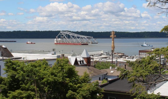 A barge carrying a section of the Tappan Zee Bridge passes Irvington southbound on the Hudson River at noon Thursday, June 6, 2019. This section, the east anchor span, was brought down in January in an emergency demolition using explosives.